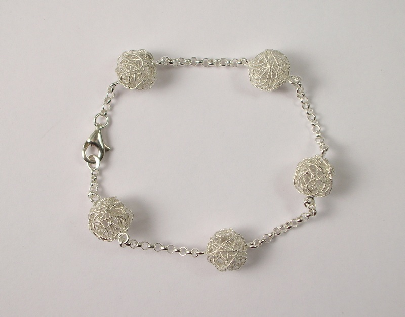 Silver bracelet with filigree