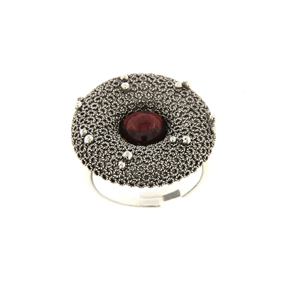 Silver filigree ring with garnet